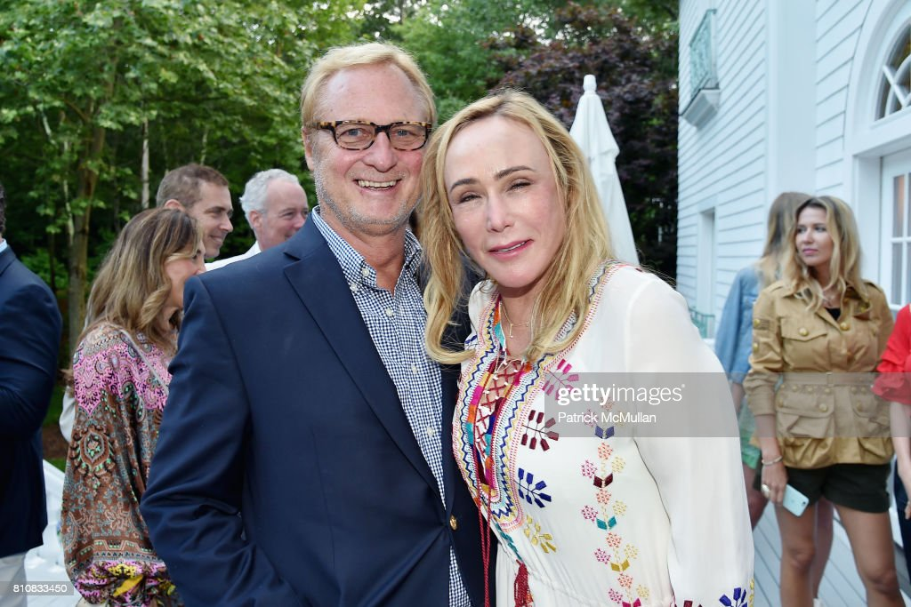 Christopher Bickford and Patty Raynes attend Katrina and Don Peebles Host NY Mission Society Summer Cocktails at Private Residence on July 7, 2017 in Bridgehampton, New York.