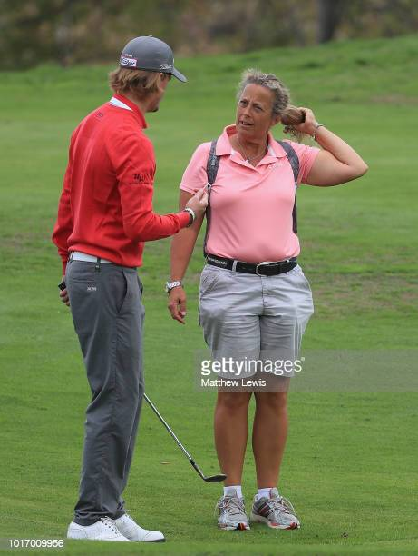 Christopher Bloomstrand of Sweden talks to Fanny Sunesson during a practice round ahead of the Nordea Masters at Hills Golf Club on August 15 2018 in...