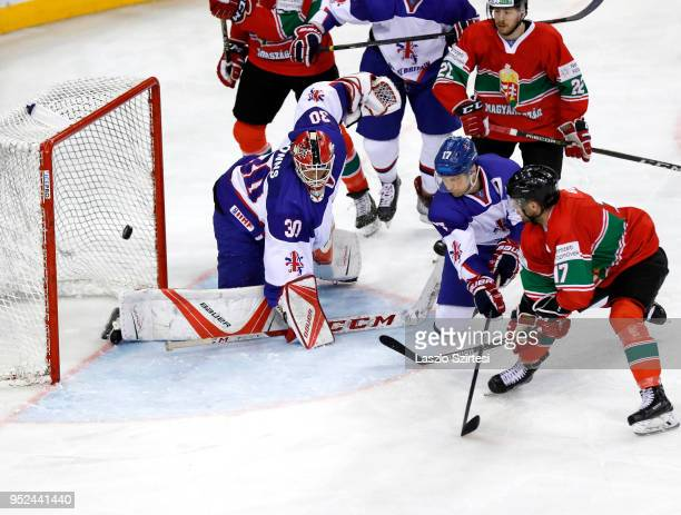 Christopher Bodo of Hungary scores next to Mark Richardson of Great Britain Janos Hari of Hungary and goalie Ben Bowns of Great Britain during the...