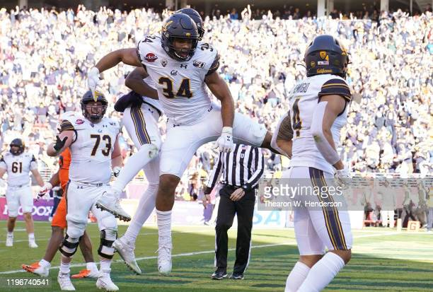 Christopher Brown Jr. #34 of the California Golden Bears celebrates with teammates after he score on a 3 yard touchdown pass against the Illinois...