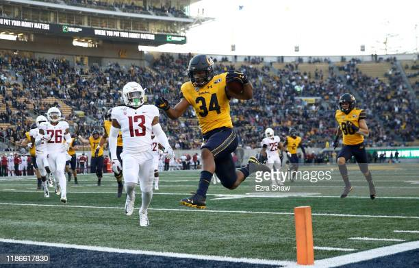 Christopher Brown Jr. #34 of the California Golden Bears runs in for a touchdown against the Washington State Cougars at California Memorial Stadium...