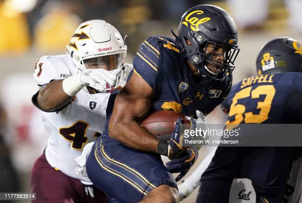 Christopher Brown Jr #34 of the California Golden Bears scores on a one yard touchdown run against the Arizona State Sun Devils during the third...