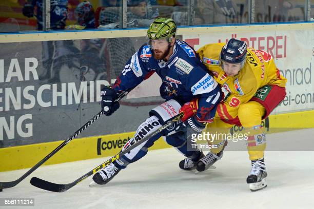 Christopher Brown of Iserlohn Roosters amd Maximilian Kammerer of Duesseldorfer EG battle for the ball during the DEL match between Iserlohn Roosters...