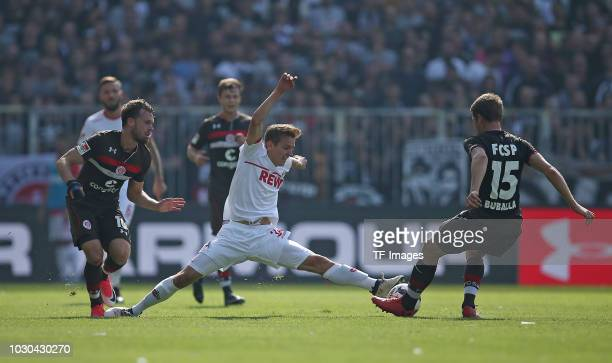 Christopher Buchtmann of FC St Pauli Niklas Hauptmann of FC Koeln Daniel Buballa of FC St Pauli battle for the ball during the Second Bundesliga...