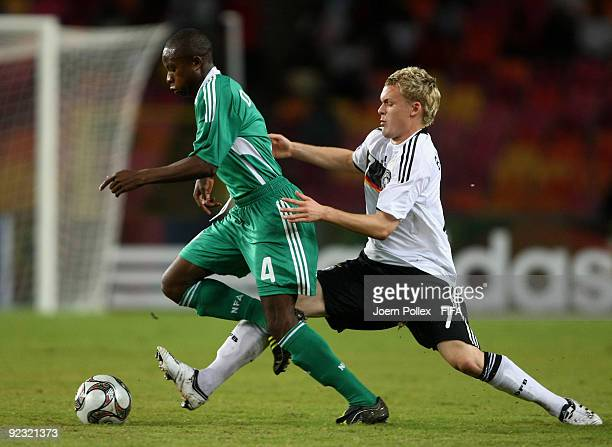 Christopher Buchtmann of Germany and Ogenyi Onazi of Nigeria battle for the ball during the FIFA U17 World Cup Group A match between Nigeria and...