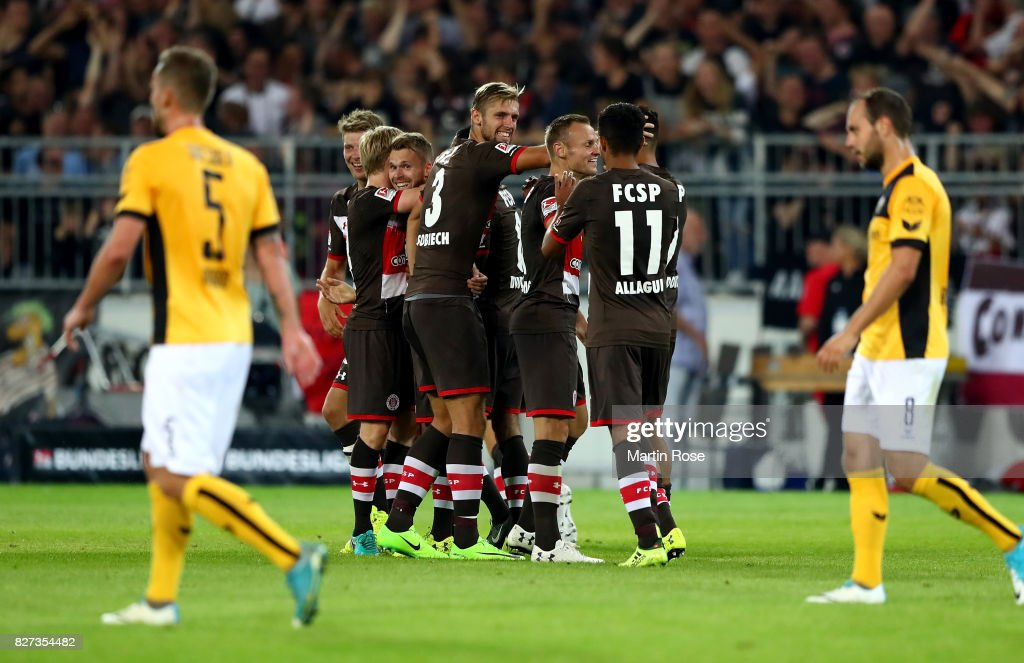 Christopher Buchtmann (obscure) of St. Pauli celebrate with his team mates afte he scores the 2nd goal during the Second Bundesliga match between FC St. Pauli and SG Dynamo Dresden at Millerntor Stadium on August 7, 2017 in Hamburg, Germany.