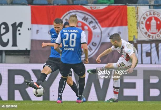 Christopher Buchtmann of St Pauli scores against Sebastian Schuppan and Florian Hartherz of Bielefeld during the Second Bundesliga match between DSC...