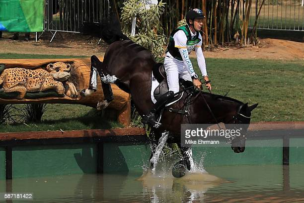 Christopher Burton of Australia riding Santano II clears a water jump during the Cross Country Eventing on Day 3 of the Rio 2016 Olympic Games at the...