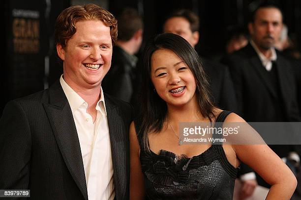 Christopher Carley and Ahney Her arrive on the red carpet for the Los Angeles premiere of Gran Torino at the Steven J Ross Theater on The Warner Bros...