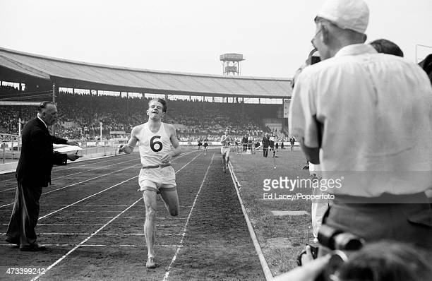 Christopher Chataway of Great Britain crosses the finish line to win the 3 mile race at the Amateur Athletics Association Championships on 16th July...