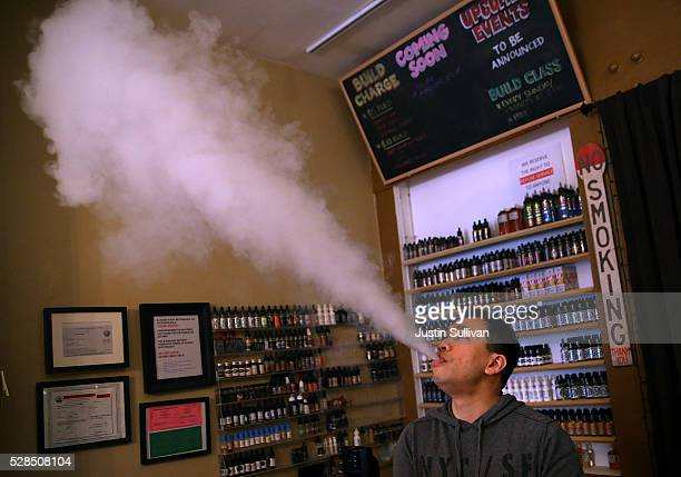 Christopher Chin blows vapor from an ecigarette at Gone With the Smoke Vapor Lounge on May 5 2016 in San Francisco California The US Food and Drug...