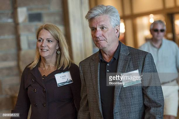 Christopher 'Chris' Waller senior vice president of the Federal Reserve Bank of St Louis right and Laurie Miller arrive for a welcome dinner during...