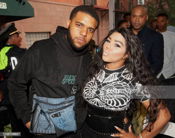 """Christopher 'CJ"""" Wallace and Lil Kim attend the Notorious B.I.G. Street Naming in Brooklyn New York on June 10, 2019 in Brooklyn, New York. On June..."""
