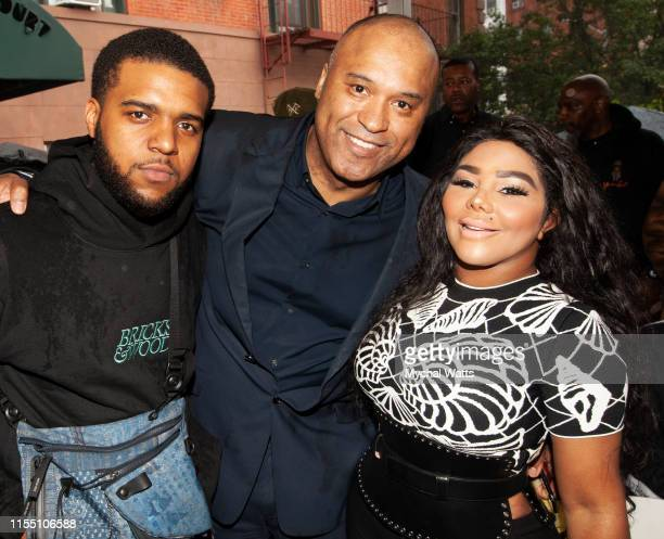 """Christopher """"CJ"""" Wallace, Londell McMillan and Lil kim attend the Notorious B.I.G. Street Naming in Brooklyn New York on June 10, 2019 in Brooklyn,..."""
