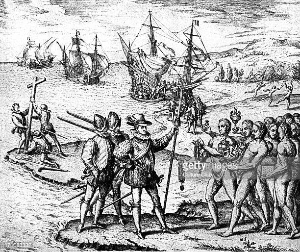 Christopher Columbus setting foot on American soil for the first time being met by the indigenous population Engraving from 'Americae partes' 1590 CC...