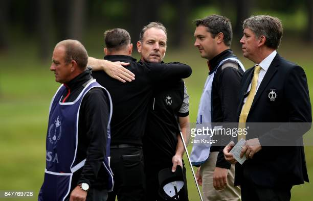 Christopher Currie of the Great Britain and Ireland PGA Cup team celebrates a point with partner David Higgins during the morning fourball matches on...