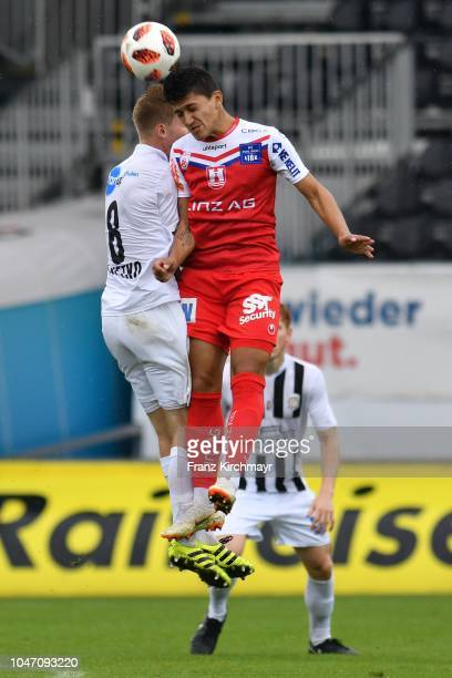 Christopher Cvetko of Juniors OOe and Alan Lima Carius of FC Linz during the 2 Liga match between FC Juniors OOe v FC Blau Weiss Linz at TGW Arena on...