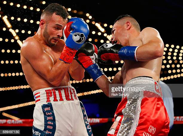 Christopher Diaz left blocks a punch by Neftali Campos during their Featherweight bout on June 11 2016 at the Theater at Madison Square Garden in New...