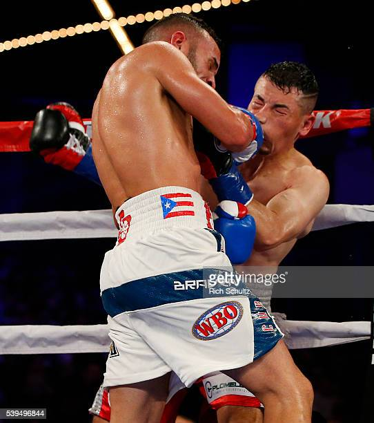 Christopher Diaz left lands a right punch to the face of Neftali Campos during their Featherweight bout on June 11 2016 at the Theater at Madison...