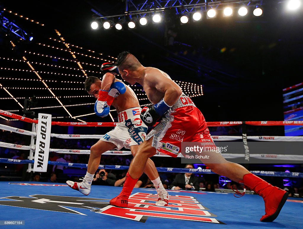 Christopher Diaz, right, ducks from a right punch by Neftali Campos during their Featherweight bout on June 11, 2016 at the Theater at Madison Square Garden in New York City. Diaz won by a TKO.