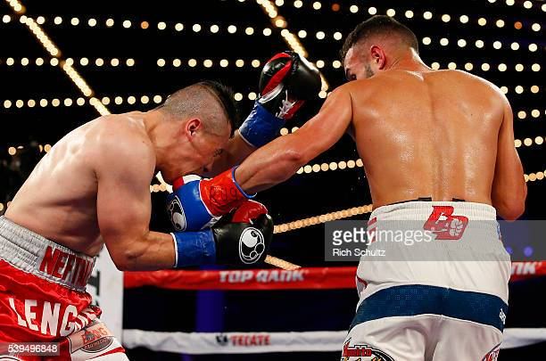 Christopher Diaz right lands a left punch to the face of Neftali Campos during their Featherweight bout on June 11 2016 at the Theater at Madison...