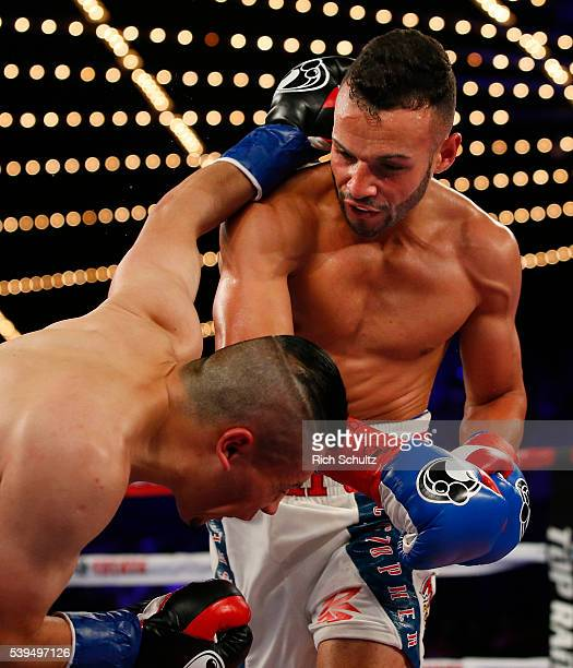 Christopher Diaz right lands a right punch to the face of Neftali Campos during their Featherweight bout on June 11 2016 at the Theater at Madison...