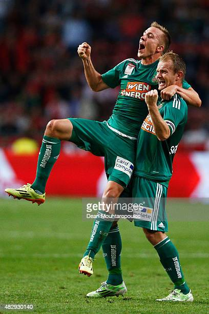Christopher Dibon and Mario Sonnleitner of Rapid Wien celebrate after victory in the third qualifying round 2nd leg UEFA Champions League match...