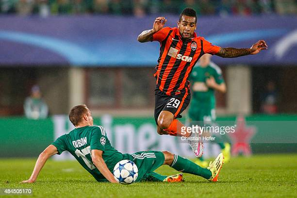 Christopher Dibon of Vienna competes for the ball with Alex Teixeira of Donetsk during the UEFA Champions League Qualifying Round Play Off First Leg...