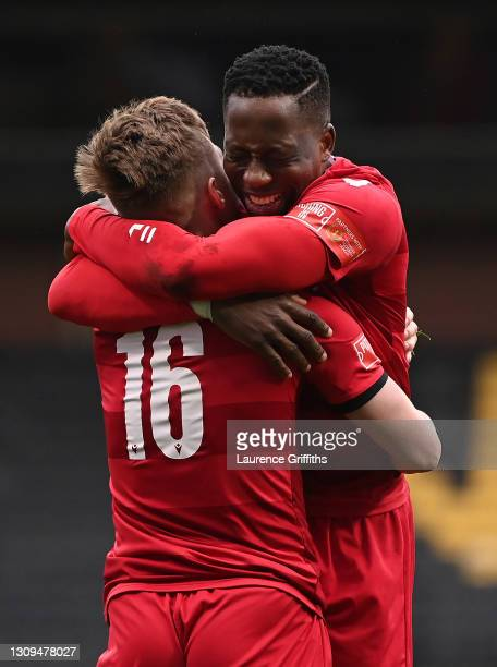 Christopher Dixon of Hornchurch celebrates scoring the winning penalty with Charlie Ruff during the FA Trophy Semi Final between Notts County and...