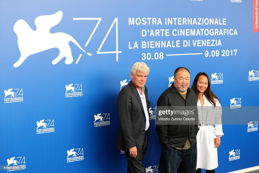 Christopher Doyle, Ai Weiwei and guest attend the 'Human Flow' photocall during the 74th Venice Film Festival on September 1, 2017 in Venice, Italy.