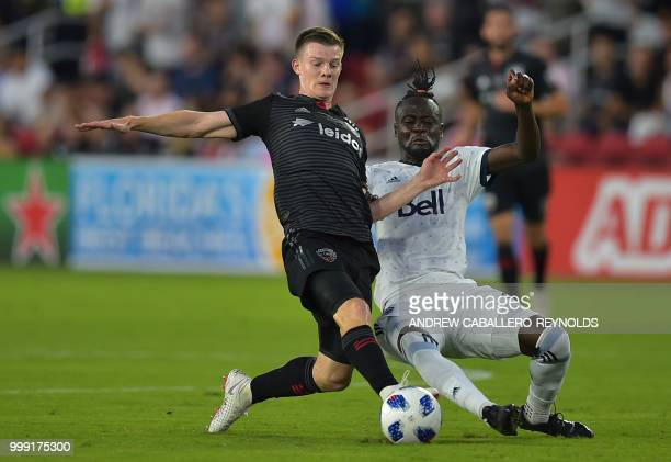 Christopher Durkin of DC United vies for the ball with Kei Kamara during the DC United vs the Vancouver Whitecaps FC match in Washington DC on July...