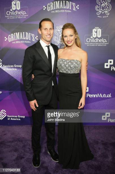 Christopher Estwanik and Caroline Campbell pose for photos during the Childhelp's 15th annual Drive The Dream Gala at The Phoenician Resort on...