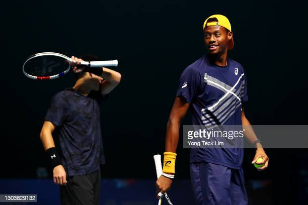 Christopher Eubanks and Thai-Son Kwiatkowski of the United States react after a play in their Men's Doubles first round match against Matthew Ebden...