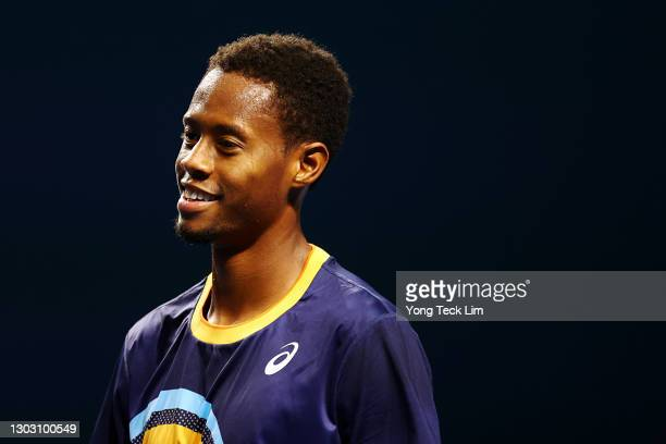 Christopher Eubanks of the United States celebrates his Men's Singles qualifying match victory against Rohan Bopanna of India during the Singapore...