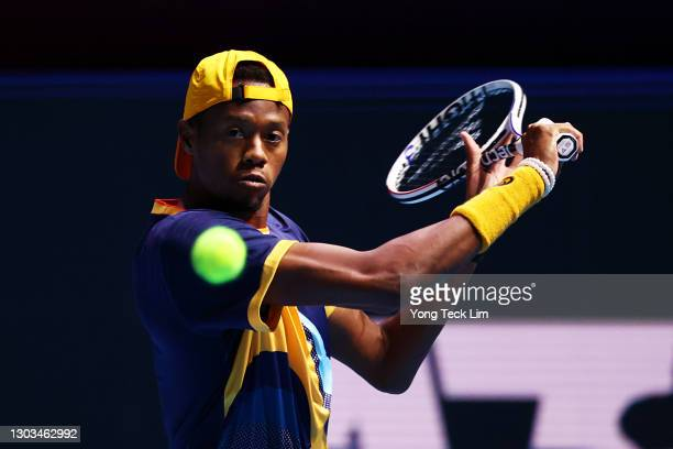 Christopher Eubanks of the United States plays a backhand in his Men's Singles first round match against Alexei Popyrin of Australia on day one of...
