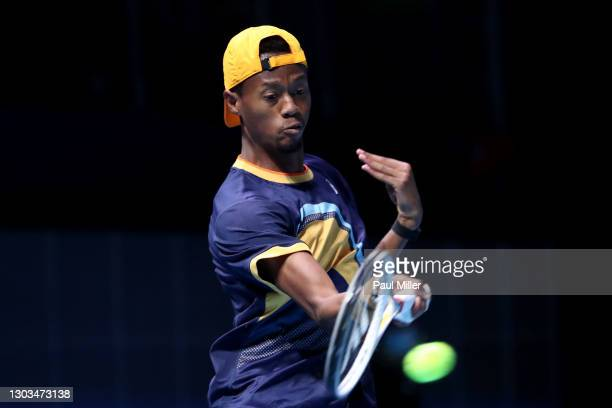 Christopher Eubanks of the United States plays a forehand in his Men's Singles first round match against Alexei Popyrin of Australia on day one of...