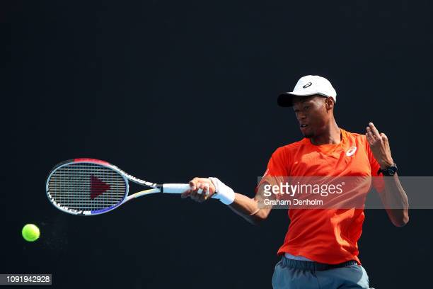 Christopher Eubanks of the United States plays a forehand in his match against Felix Auger-Aliassime of Canada during day three of Qualifying ahead...