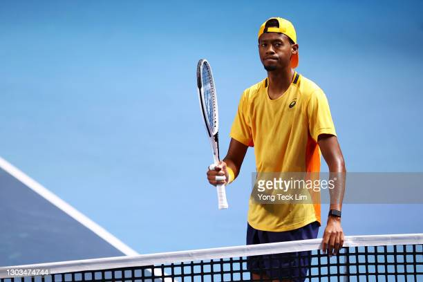 Christopher Eubanks of the United States reacts after conceding a point in his Men's Singles first round match to Alexei Popyrin of Australia on day...