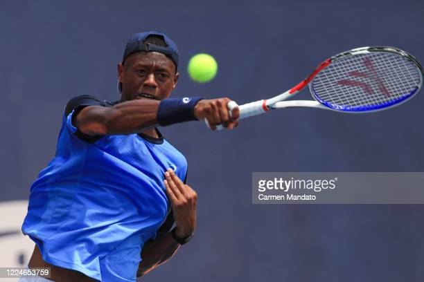 Christopher Eubanks of the United States returns a ball during the singles match against Tennys Sandgren of the United States during the DraftKings...