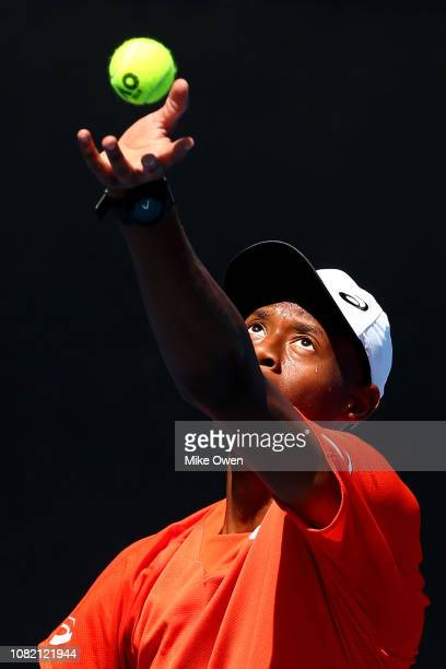 Christopher Eubanks of the United States serves in his first round match against Nikoloz Basilashvili of Georgia during day one of the 2019...