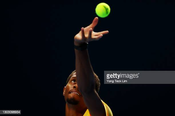 Christopher Eubanks of the United States serves in his Men's Singles qualifying match against Rohan Bopanna of India during the Singapore Tennis Open...