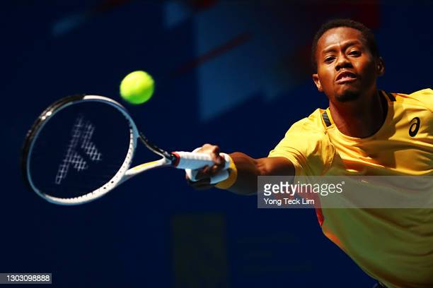 Christopher Eubanks of the United States stretches for a forehand in his Men's Singles qualifying match against Rohan Bopanna of India during the...