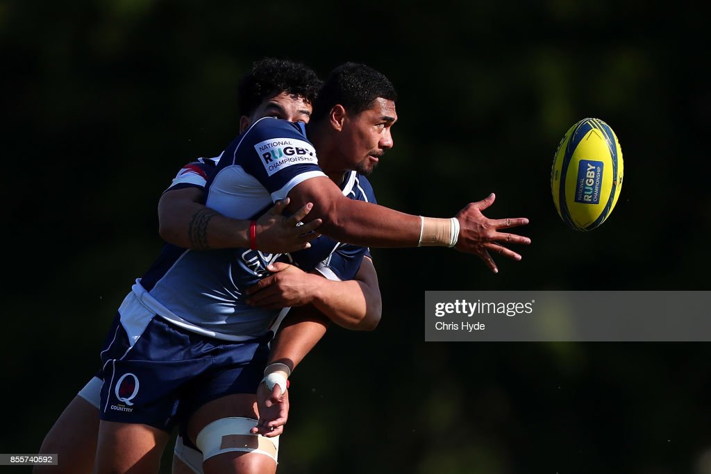 Christopher Feauai-Sautia of Queensland Country offloads while tackled during the round five NRC match between Queensland Country and Melbourne at Bond University on September 30, 2017 in Brisbane, Australia.
