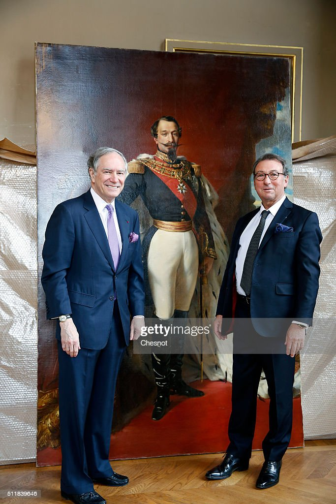 Christopher Forbes (L), vice chairman of Forbes and auctioneer Jean-Pierre Osenat (R) pose next to a painting of Napoleon III in ceremonial costume during the installation of his collection of souvenirs from the Second Empire during a press preview at the Opera Garnier on February 23, 2016 in Paris, France. The famous American billionaire Christopher Forbes and vice chairman of Forbes decided to disperse his collection of souvenirs from the Second Empire. Christopher Forbes collection consists of over 2,000 art objects, paintings, sculptures, manuscripts, photographs and other historical souvenirs and the Wedding Certificate of Emperor Napoleon I and Empress Josephine (1804), all for a total value estimated between 3 and 4 million euros. This world's largest unique private collection will be auctioned on 5 and 6 March 2016 in Fontainebleau (Seine-et-Marne).