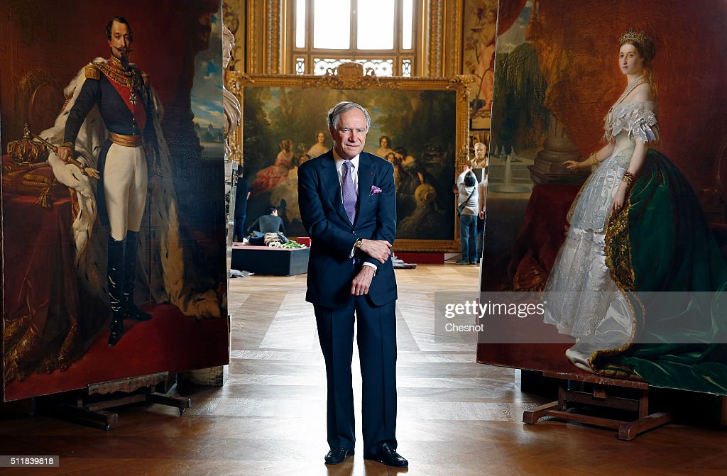 Christopher Forbes, vice chairman of Forbes, poses between paintings of Napoleon III (L) and his wife Empress Eugenie (R) during a press preview at the Opera Garnier on February 23, 2016 in Paris, France. The famous American billionaire Christopher Forbes and vice chairman of Forbes decided to disperse his collection of souvenirs from the Second Empire. Christopher Forbes collection consists of over 2,000 art objects, paintings, sculptures, manuscripts, photographs and other historical souvenirs and the Wedding Certificate of Emperor Napoleon I and Empress Josephine (1804), all for a total value estimated between 3 and 4 million euros. This world's largest unique private collection will be auctioned on 5 and 6 March 2016 in Fontainebleau (Seine-et-Marne).