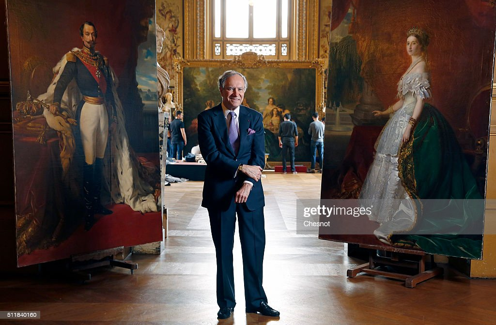 Christopher Forbes, vice chairman of Forbes poses between paintings of Napoleon III (L) and his wife Empress Eugenie (R) during a press preview at the Opera Garnier on February 23, 2016 in Paris, France. The famous American billionaire Christopher Forbes and vice chairman of Forbes decided to disperse his collection of souvenirs from the Second Empire. Christopher Forbes collection consists of over 2,000 art objects, paintings, sculptures, manuscripts, photographs and other historical souvenirs and the Wedding Certificate of Emperor Napoleon I and Empress Josephine (1804), all for a total value estimated between 3 and 4 million euros. This world's largest unique private collection will be auctioned on 5 and 6 March 2016 in Fontainebleau (Seine-et-Marne).