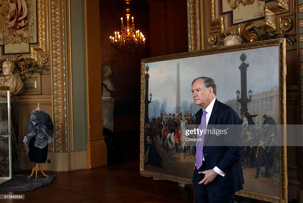 Christopher Forbes, vice chairman of Forbes poses in front of a painting of the Emperor Napoleon III with Prince Jerome acclaimed by the crowd as they review the Gendarmerie Mobile by Victor de Jonquieres during a press preview at the Opera Garnier on February 23, 2016 in Paris, France. The famous American billionaire Christopher Forbes and vice chairman of Forbes decided to disperse his collection of souvenirs from the Second Empire. Christopher Forbes collection consists of over 2,000 art objects, paintings, sculptures, manuscripts, photographs and other historical souvenirs and the Wedding Certificate of Emperor Napoleon I and Empress Josephine (1804), all for a total value estimated between 3 and 4 million euros. This world's largest unique private collection will be auctioned on 5 and 6 March 2016 in Fontainebleau (Seine-et-Marne).