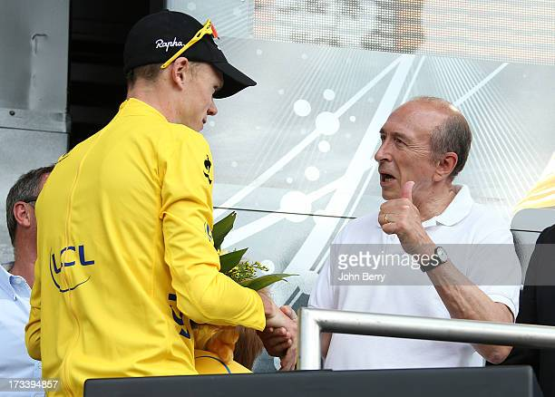 Christopher Froome of Great Britain and Team Sky Procycling here congratulated by Gerard Collomb mayor of Lyon keeps the leader's yellow jersey after...