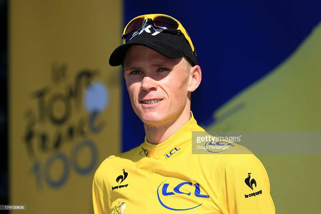 Christopher Froome of Great Britain and Team Sky Procycling celebrates on the podium as he secures the leader's yellow jersey after stage twenty of the 2013 Tour de France, a 125KM road stage from Annecy to Annecy-Semnoz, on July 20, 2013 in Annecy, France.