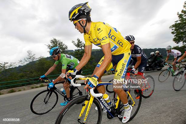 Christopher Froome of Great Britain and Team Sky wearing the green jersey and Alberto Contador of Spain and Team TinkoffSaxo wearing the yellow...